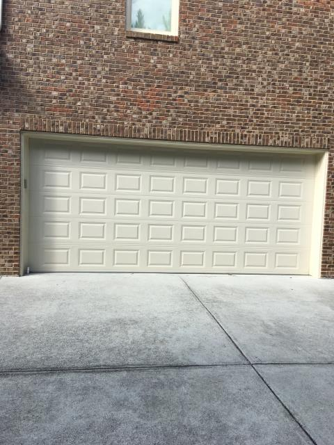 Grayson, GA - Installing a new garage door because the customer was ready for a replacement.