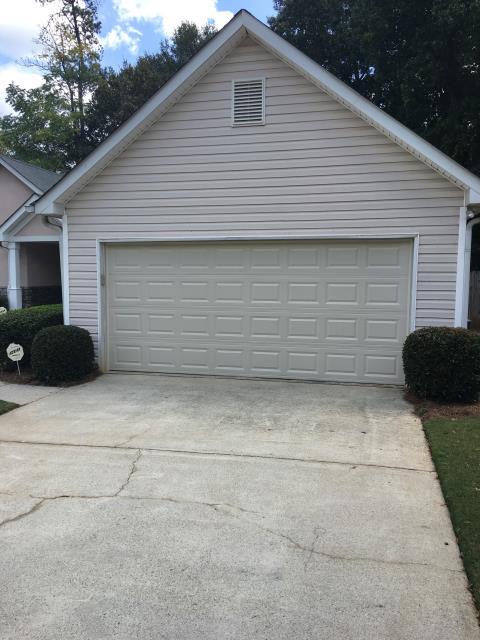 Suwanee, GA - Garage door replacement & installation today with new garage door opener. Liftmaster opener with insulated CHI garage door.