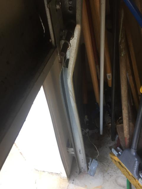 Flowery Branch, GA - Inspecting the garage door for damage. Customer is stating the door is having problems going up and down. Track is bent and needs to be replaced. Scheduled appointment for garage door repair in a few hours.