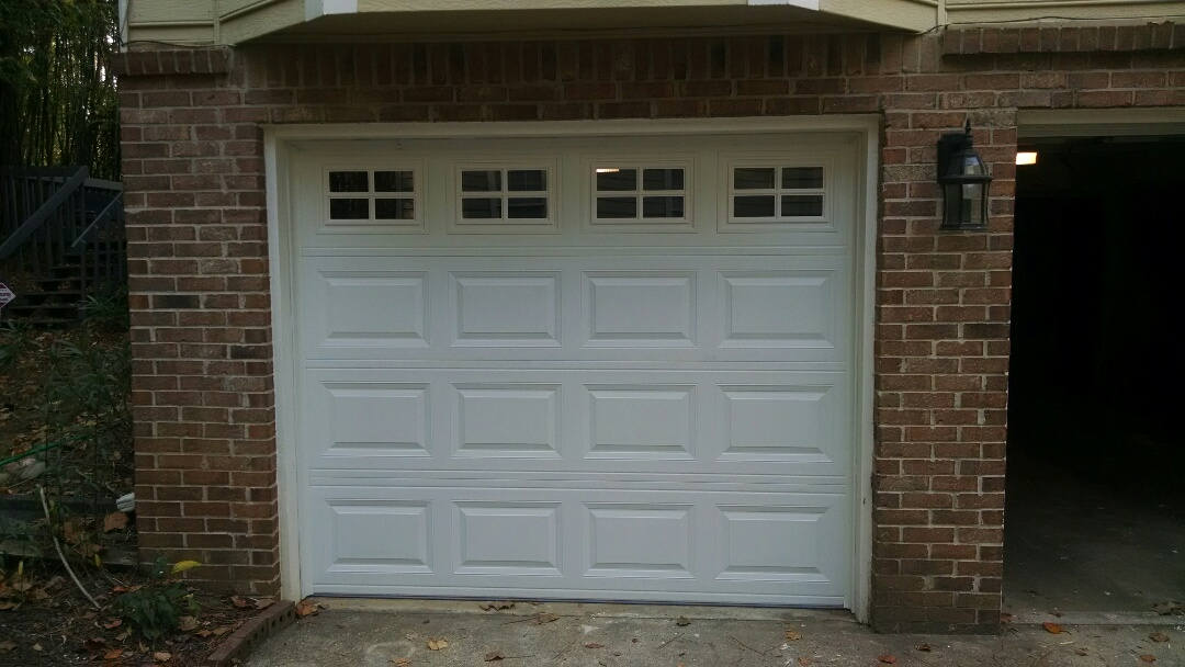 Snellville, GA - New insulated garage door with windows and a liftmaster garage door opener being installed today.