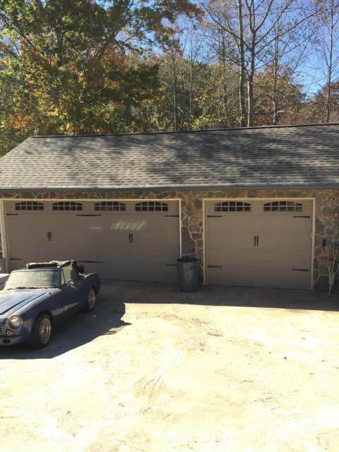 """Gainesville, GA - Installing new carriage style garage doors with with windows and insulation. Also installing two new garage door liftmaster openers.  18x7'9"""" & 9x7'9"""" doors."""