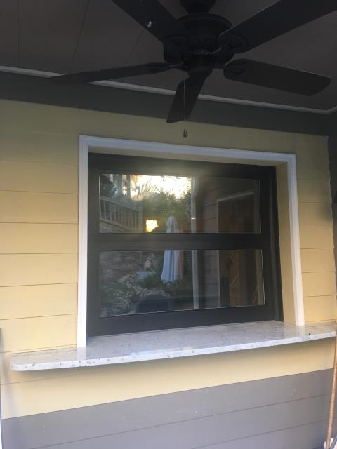 Cumming, GA - Installed a 5x4 full view glass garage door powder coated black with appearance package. Customer wanted to connect the space in his basement with the living area outside.