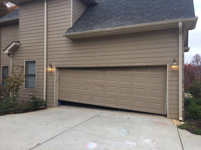 Suwanee, GA - Door is off track. Placing door back on the track. Door has damage and motor is old. Customer purchased  a new 18x7 steel insulated carriage style garage door CHI 5983 with windows and a liftmaster 8355W belt drive opener.