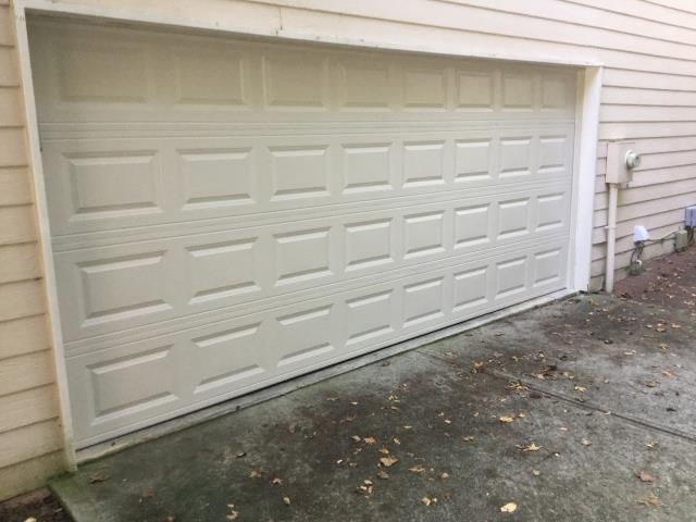 Suwanee, GA - Installed this 16x7 short panel raised garage door from CHI. Model 2283 with no windows. We reconnected customers opener and reset limits.