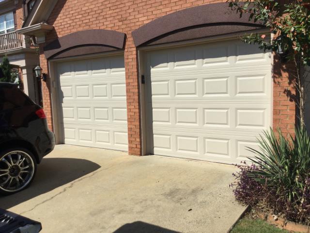Suwanee, GA - Installed two 8x7 garage doors short panel raised. CHI Overhead Doors model 2250. Reconnected motor and reset limits.
