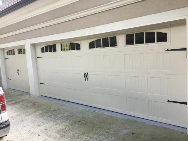 "Alpharetta, GA - Installing two garage doors. 18x7 and 9x7. The 18x7 is near the entry door so we installed a 32"" radius track to clear the entry door. We also converted the trolley garage door opener to a side mount garage door opener (Liftmaster 8500w)."