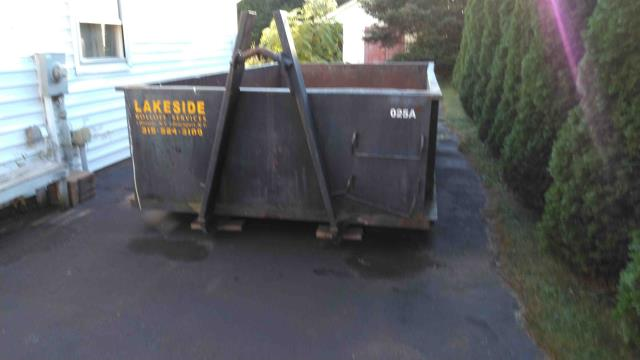 """Spencerport, NY - Spencerport NY delivery. This is our smallest 10 yard dumpster. The dimensions of this box are  : 8' wide x 14' Long x 43"""" high. Normally our customers can put on average 2-4 tons in one of these boxes. It depends on how you load it & how bulky the material is you are putting in it."""
