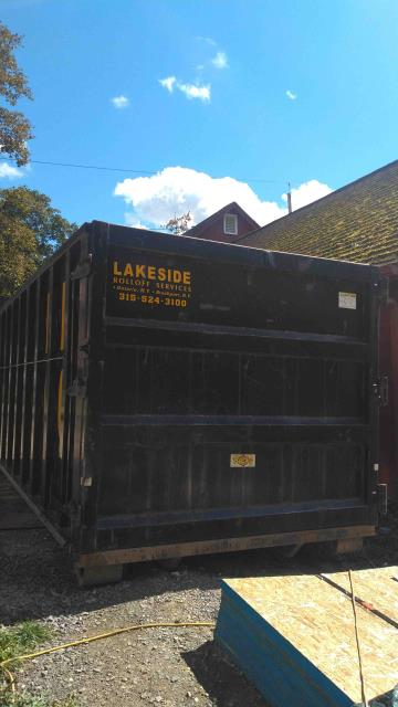 """Penfield, NY - One of our many BIG Dumpsters. We delivered this 40 yard box to Penfield NY this morning. The Dimensions of a 40 yard boxes are: 8' wide x 22' long x 94"""" tall. These boxes can hold a lot of material. Good for demo work & large commercial projects.  On average they hold 8-10 ton of Construction Debris C&D."""