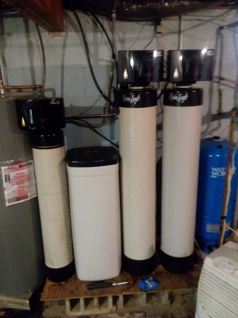Waterloo, IA - Checking over the AQC whole house treatment system! Changing filters on the UF50 drinking water purifier and replacing the mineral in the Rainsoft Oxytech whole house iron filter!