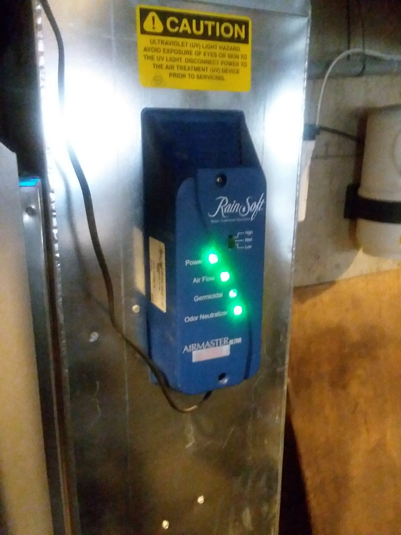 Charles City, IA - Changing the virus killing bulbs in the Rainsoft AirMaster Ultra! Changing filters on the UF50 drinking water system.