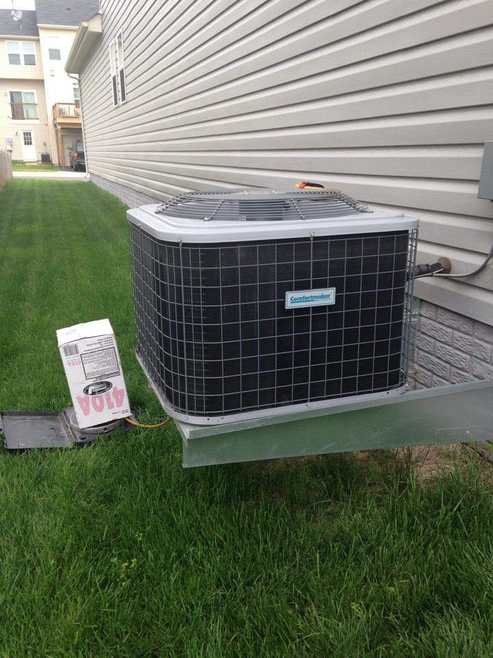 Chantilly, VA - Working in a Comfortmaker air conditioner. Added Puron and performed a full cooling inspection.