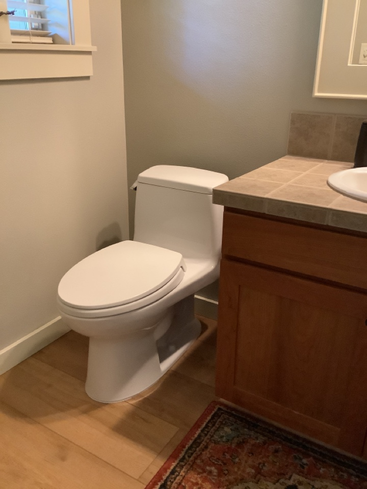 Reinstalled customer toilet that was removed for new floor installation. Replaced wax ring and new toilet flange bolts. Installed new braided ice maker line for refrigerator.