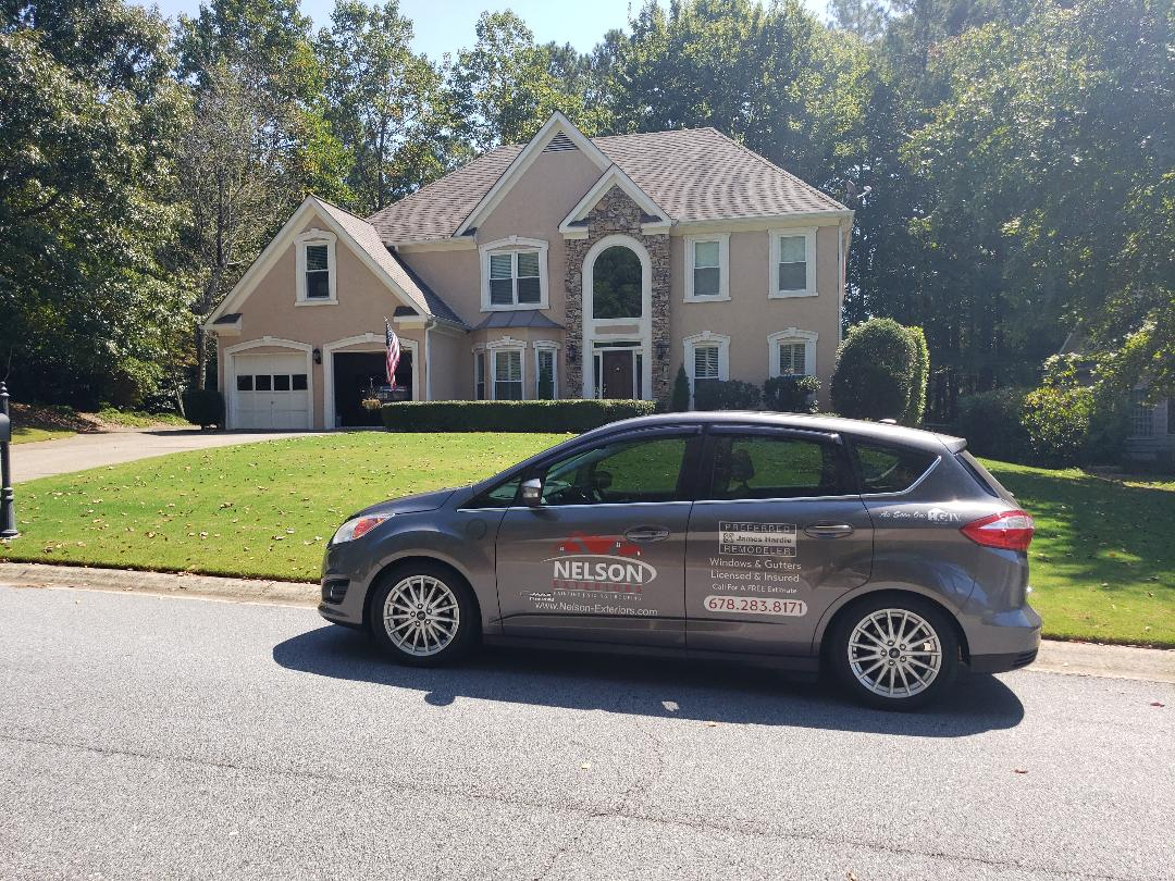 Woodstock, GA - Installing new James Hardie Siding painting entire house using Sherwin-Williams resilience paint