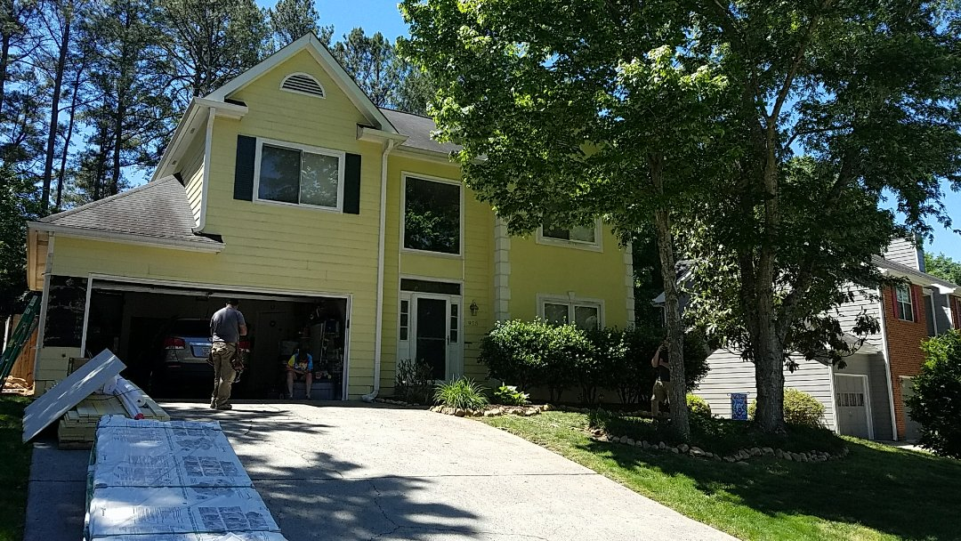 Marietta, GA - Replacing Siding in the entire house with Hardie plank siding and painting the exterior of the house.  Also repairing termite damage.