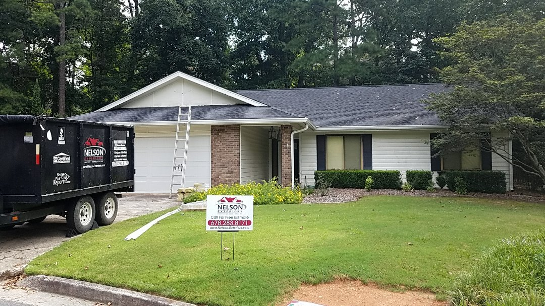 Roswell, GA - Replacing Siding on the chimney with Hardieplank Siding and panels in the front with Hardie Shingle Shake and Painting the entire exterior with Sherwin Williams Resilience.