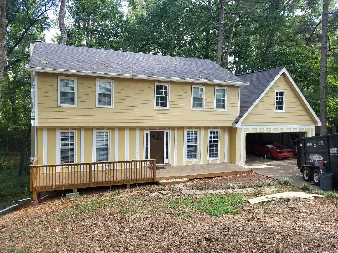 Woodstock, GA - Removing and installing board and batten and lap Siding.