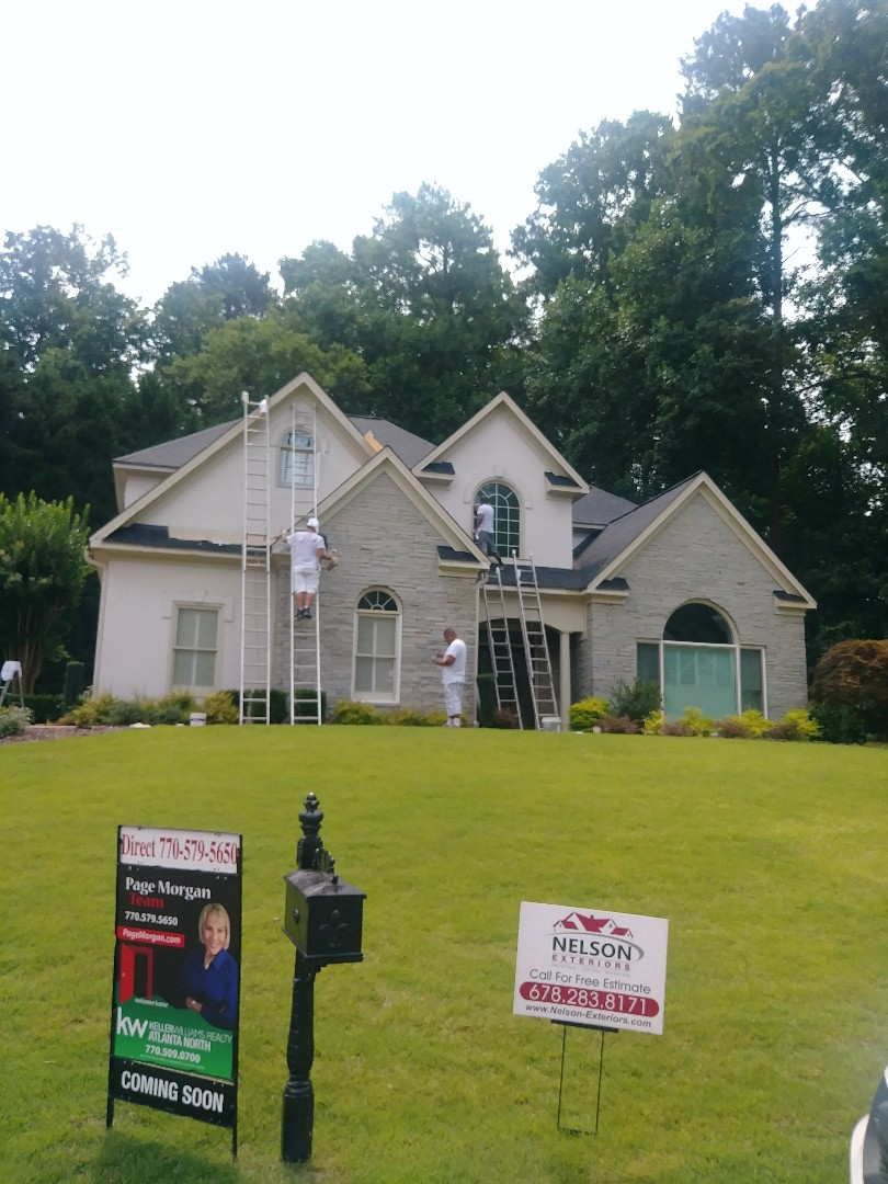 Marietta, GA - Painting exterior with Sherwin Williams Resiliance! Replaced chimney casing and some siding with James Hardie ®. This house won't last a day on the market once were done with the upgrades!