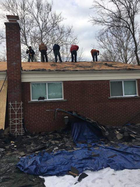 Southfield, MI - Out with the old and in with the new. We are tearing off this old roof and replacing rotted plywood to make way for a new GAF roof today!