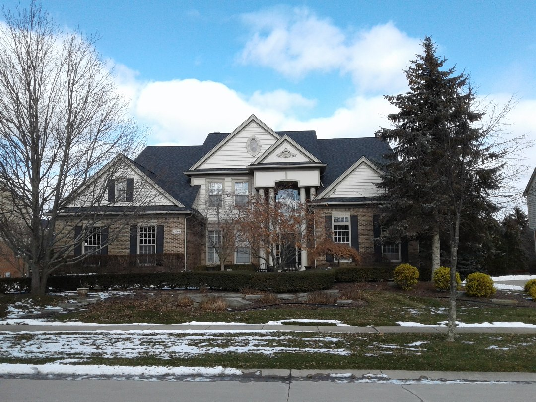 Novi, MI - Beautiful home that we completed over the recent months. Look at those beautiful CertainTeed Landmark Pro shingles color is Moire Black!