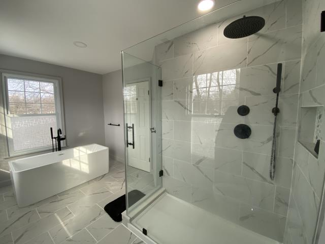 North Brunswick Township, NJ - Complete bathroom remodel with a new freestanding tub, walk-in shower with a rain shower head, and. new wooden style double vanity.