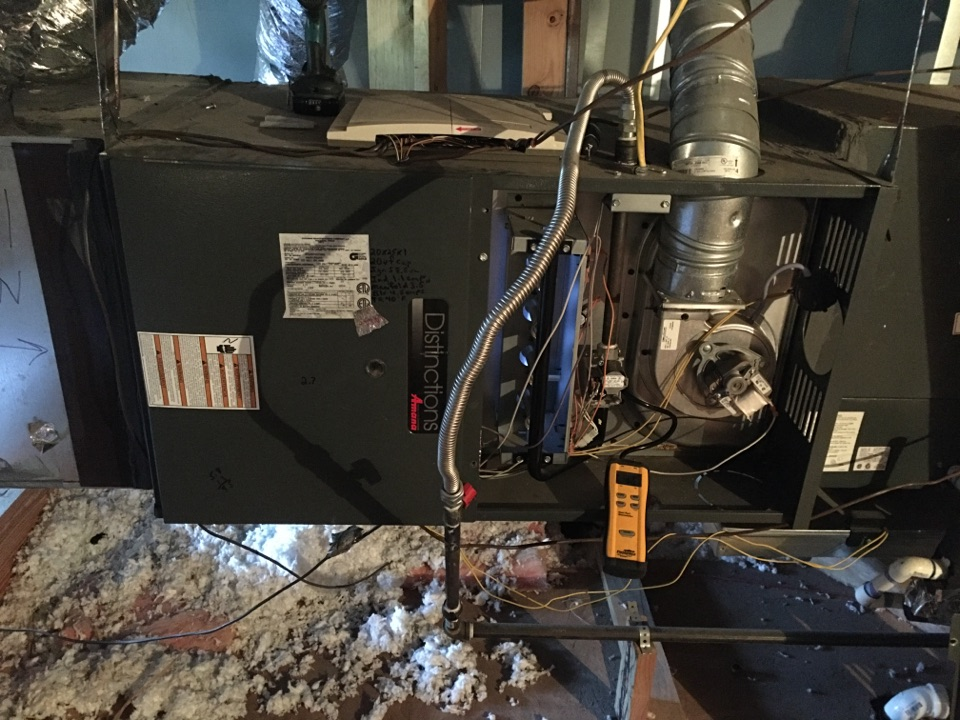 Performing a heating tune up on one Amana gas furnace