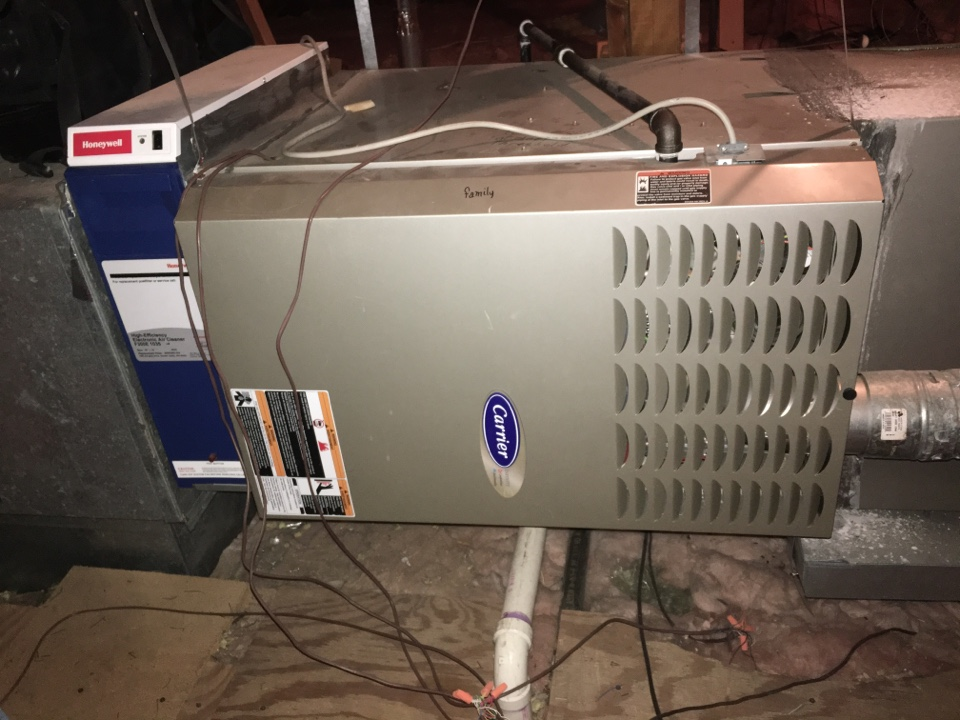 Farmers Branch, TX - Performing a heating tune up on two Carrier gas furnaces