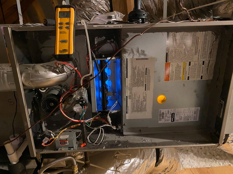 Coppell, TX - Performing a heating tune up on two Carrier gas furnaces