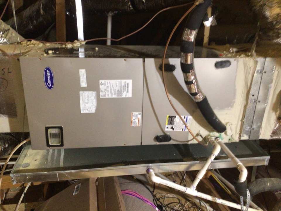 Carrollton, TX - Performing a heating tune up on two Carrier heat pump system