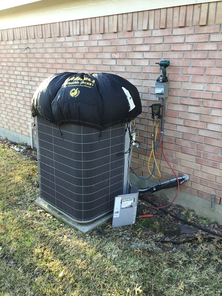 Lewisville, TX - Performing a cooling tune up on one Carrier system