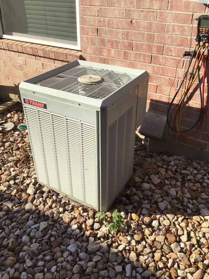 Coppell, TX - Performing an air conditioning tune up on three Trane systems