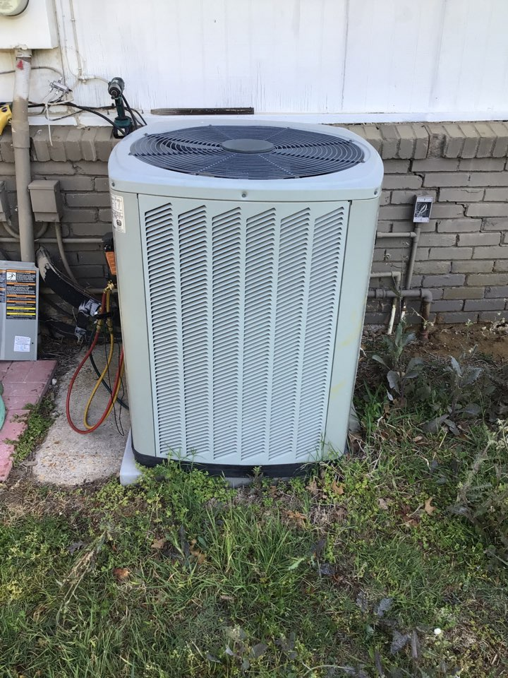 Flower Mound, TX - Performing an air conditioning tune up on one Trane system