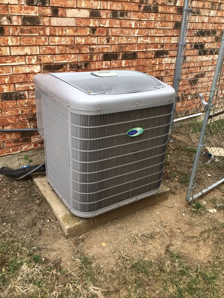 The Colony, TX - Performing an air conditioning tune up on one Carrier system