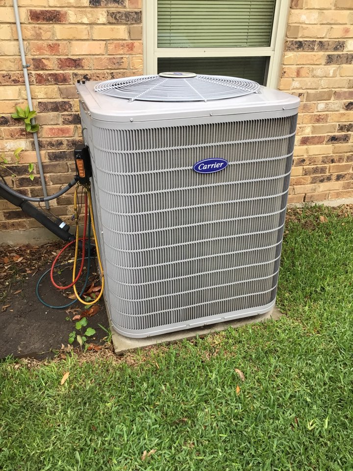 Dallas, TX - Performing an air conditioning tune up on one Carrier system