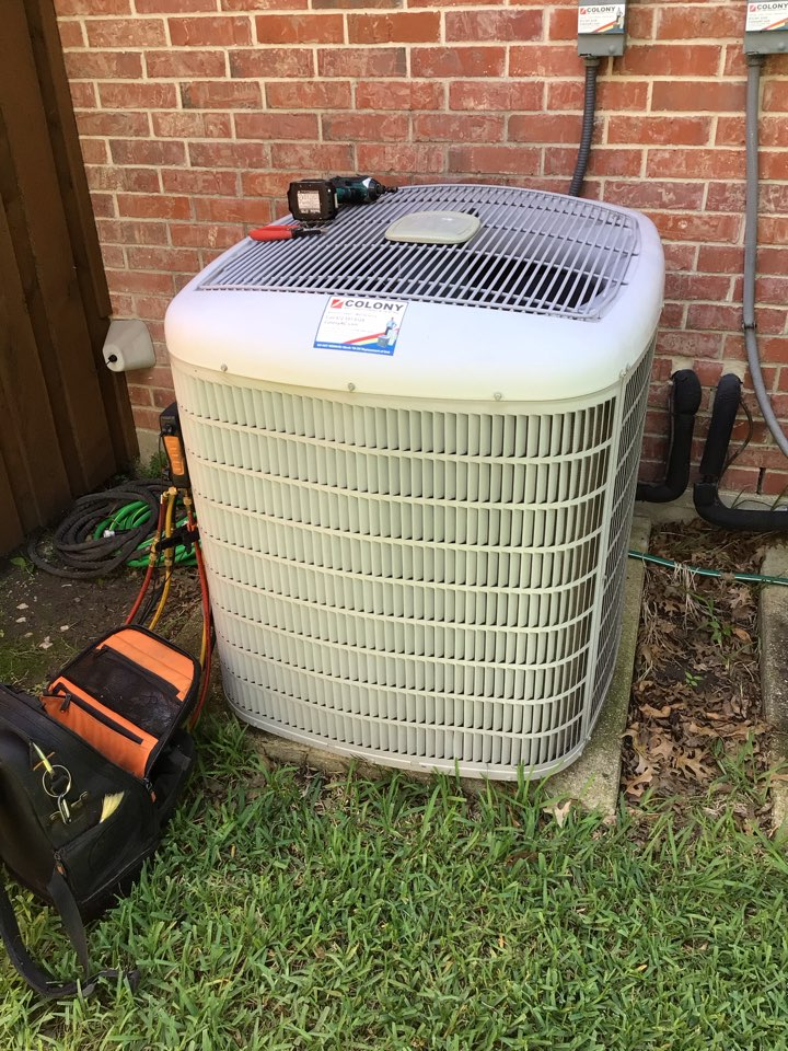 Farmers Branch, TX - Performing an air conditioning repair on one Carrier system