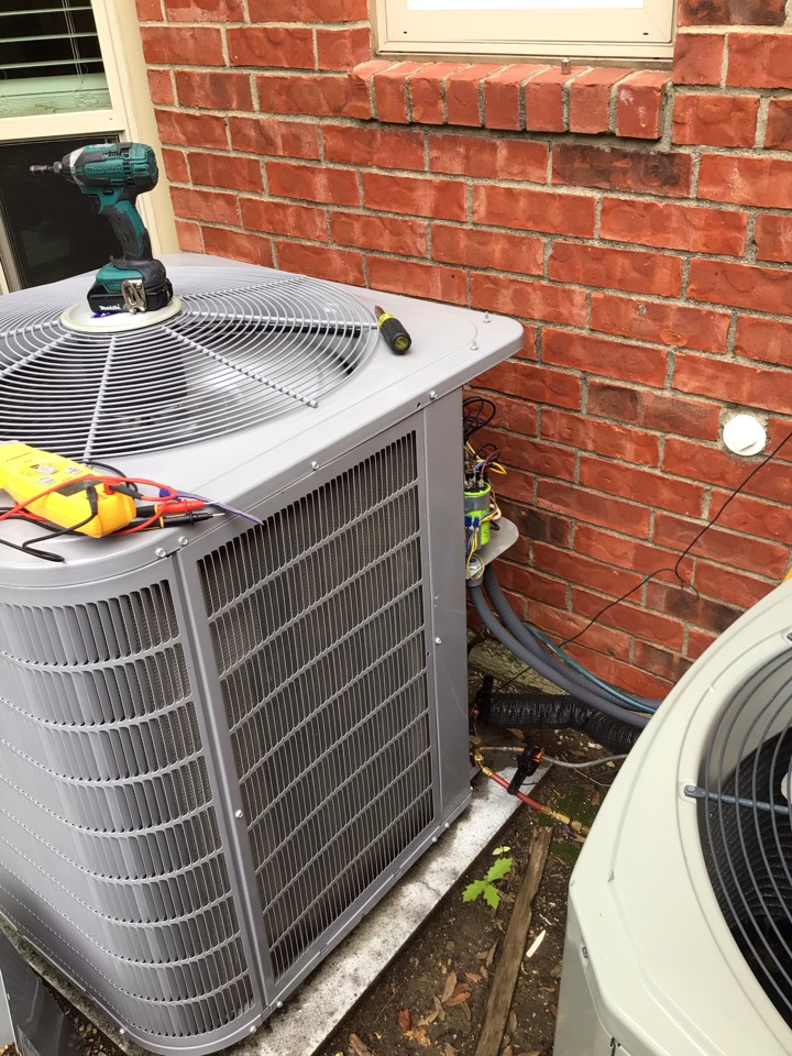 Carrollton, TX - Performing a cooling service call on one Carrier system