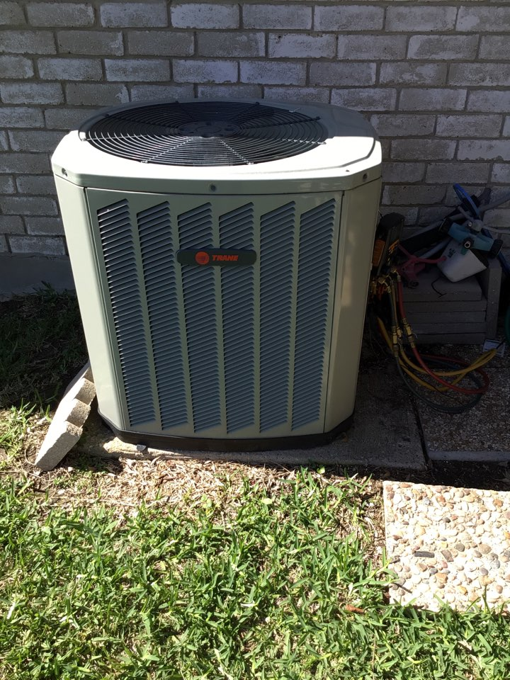 Carrollton, TX - Performing a minor AC repair on one Trane system