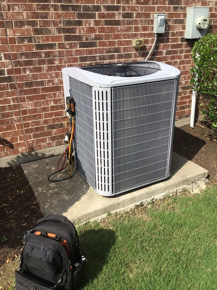 Frisco, TX - Performing a cooling tune up on one Carrier system