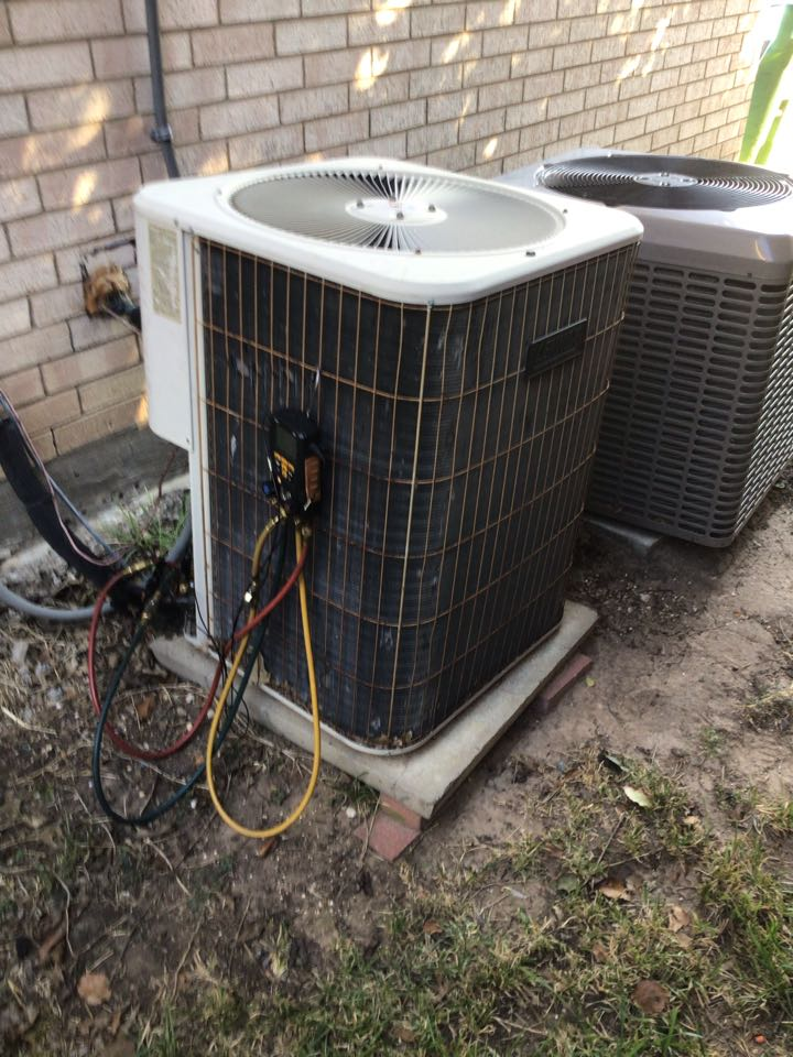 The Colony, TX - Performing a heat and cooling tune up on two systems.