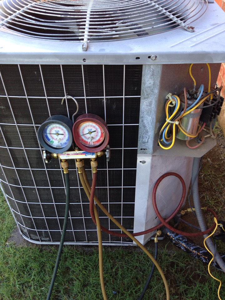Highland Village, TX - Air conditioning repair and maintenance service call.