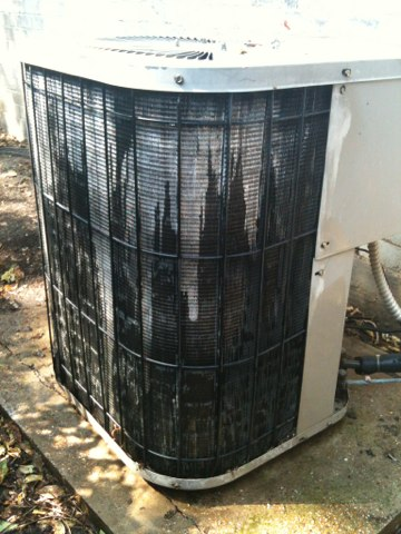 Richardson, TX - Working on an old Goodman air conditioner with lots of condenser fin damage. Possibly caused by a pressure washer from the looks of it.