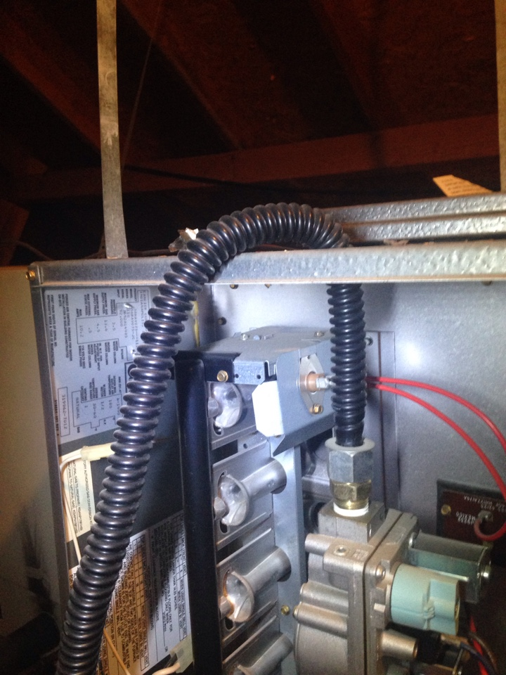 Highland Village, TX - Completing a 2 furnace heating tune up and heater repair. Gas line flex connectors should never go through the furnace cabinet. This is not only very dangerous but is a code violation. Check yours and give us a call right away if it does.