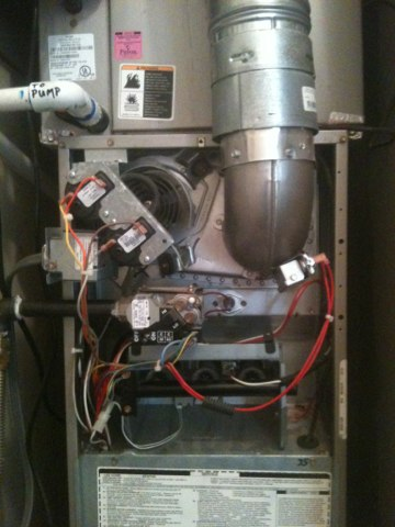 Farmers Branch, TX - heating Maintenance on a Carrier furnace.