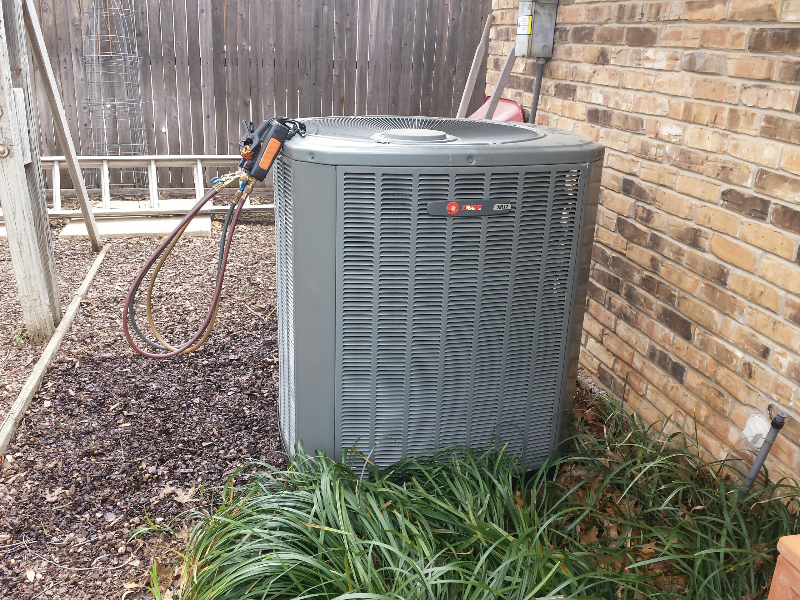 Farmers Branch, TX - Performing seasonal cooling tuneup and inspection on a TRANE air conditioning system.