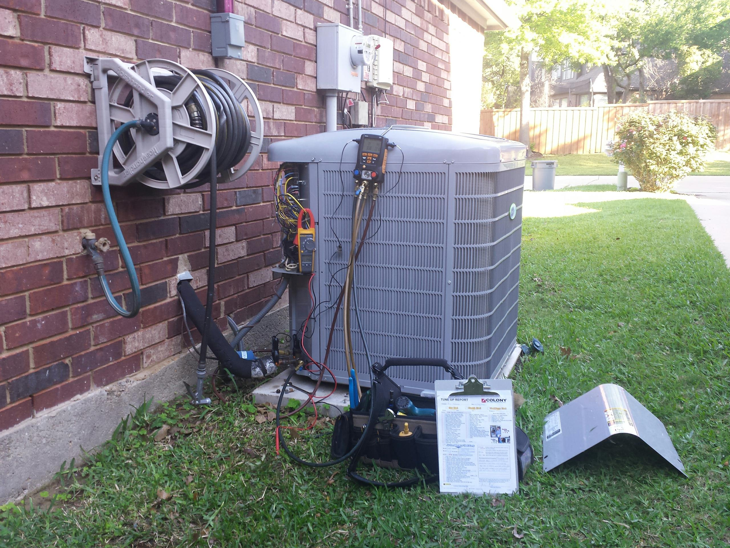 Highland Village, TX - air conditioning service and repair and inspection on a CARRIER AC system in Highland Village.