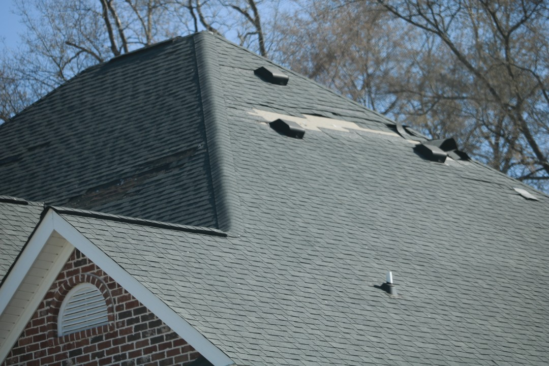 Evans, GA - Inspecting 30 year architectural roof of about 15 years of age with massive amounts of wind damage from the storm on Sunday March 3 2019 (03/03/19)