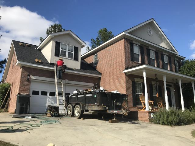 Martinez, GA - Giving the roof its final touches. This was a shingle roof replaced due to storm damage. Customer upgraded to Architectural shingles.