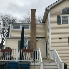 Itasca, IL - Estimating to rebuild upper portion of chimney for a homeowner in Itasca, IL.  We will also form and pour a new concrete cap and spot tuckpoint the lower part of chimney to the ground.
