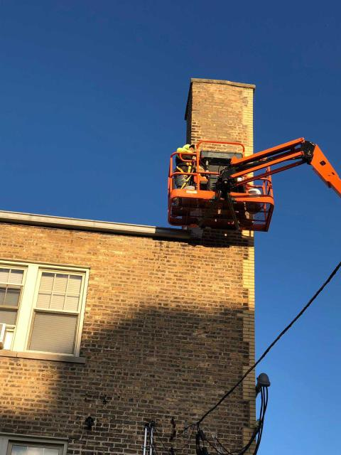 Evanston, IL - North Shore Brickwork hard at work tuckpointing the chimney on Sherman Avenue in Evanston, IL for a property management customer.