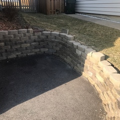 Palatine, IL - Evaluating a stone garden wall for masonry work for a homeowner in Palatine, IL.
