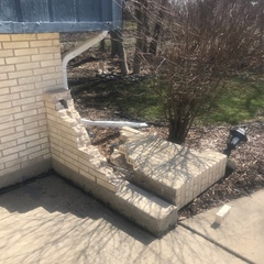 Arlington Heights, IL - Estimating vehicle damaged wing wall for a homeowner.